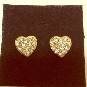 Gold tone heart shaped cubic zirconia earrings.